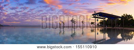The Cairns lagoon pool reflections at sunrise
