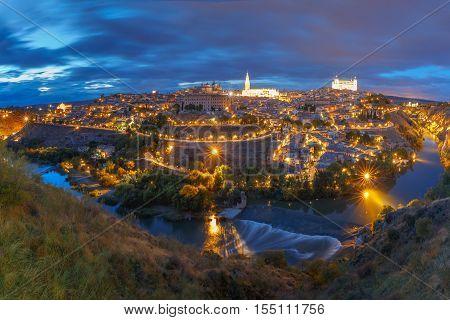 Panorama of Old city of Toledo and river Tajo at night, Castilla La Mancha, Spain