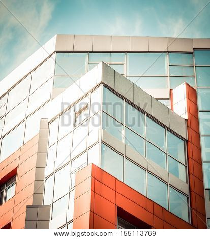 red-blue facade of urban buildings. Red-blue facade of urban buildings. On a bright sunny day with blue sky