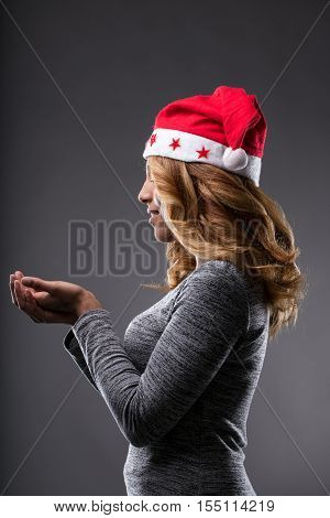 Chrismas Costume On A Girl Holding A Placeholder (side Perspecti