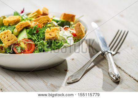 Fresh Caesar Salad On Old White Table