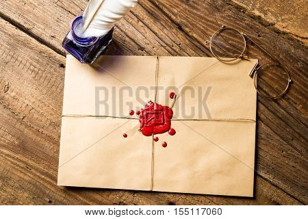 Envelope With Imprinted Sealing Wax And Inkwell With Blue Ink