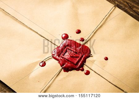 Close-up On An Envelope With Red Sealing Wax And Old Thin Rope
