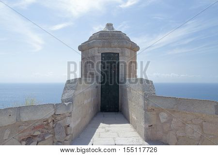 sentry box in santa barbara castle with the sea and sky in the background