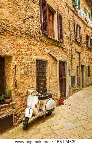 Vespa on a small street in the old town Italy