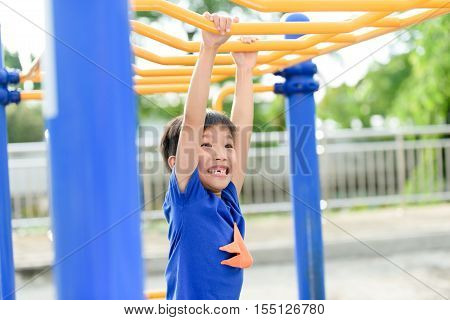 Young Boy Play With Yellow Bar