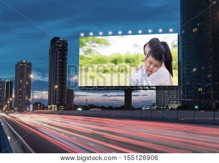 Information billboard about the family women and children divorce on a highway in the city with space for text and logo. Concept of advertising business
