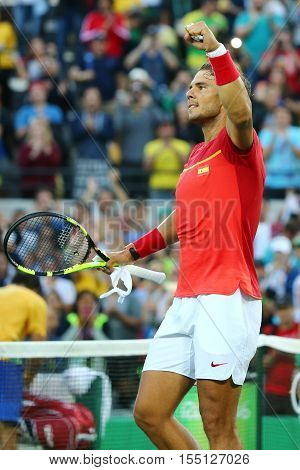 RIO DE JANEIRO, BRAZIL - AUGUST 12, 2016: Olympic champion Rafael Nadal of Spain celebrates victory after men's singles quarterfinal of the Rio 2016 Olympic Games at the Olympic Tennis Centre