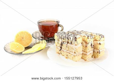 strong tea with a slice of lemon and sweet cake
