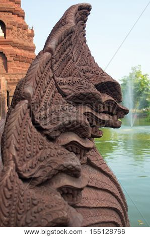 Statues of mythical creatures. Mythical animal keeper sanctuary. Huay Kaew temple in Lopburi, Thailand.