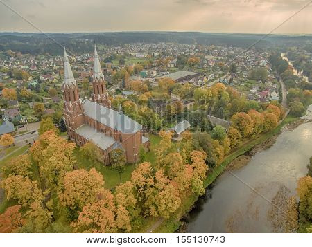 Anyksciai, Lithuania: aerial UAV top view of neo-gothic roman catholic church in the autumn