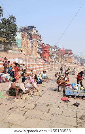VARANASI, UTTAR PRADESH, INDIA - FEBRUARY 17, 2016 - Unidentified crowd of indian people doing different activities on the ghats