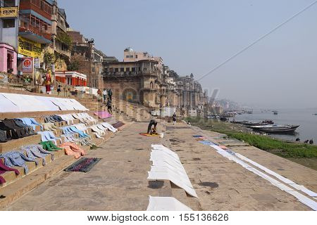 VARANASI, UTTAR PRADESH, INDIA - FEBRUARY 17, 2016 - View of the city with clothes drying on the ghats