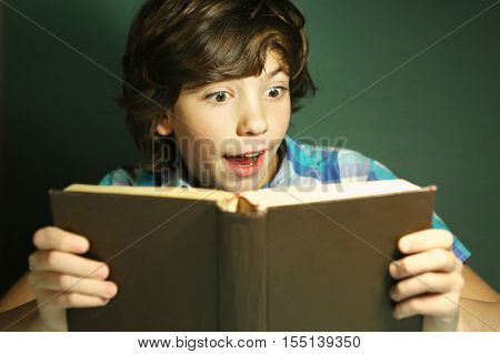 preteen hansome boy reading book have fun. Reading boy