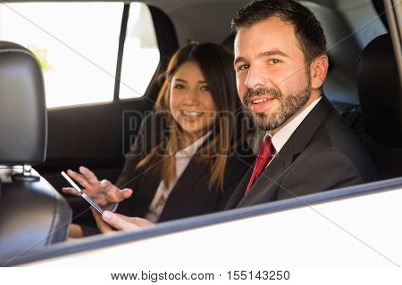 Businessman And Woman Working In A Car