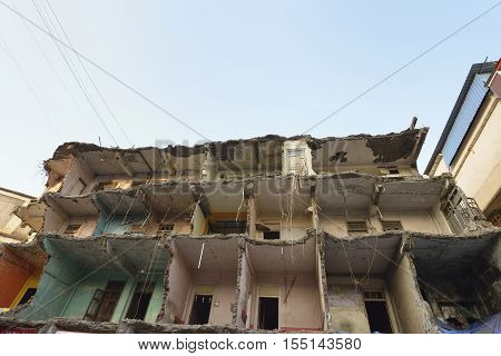 Front View of Abandoned Demolished Building .