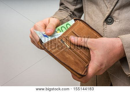 Leather Wallet With Euro Money In Male Hands