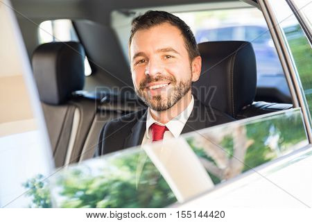 Hispanic Businessman Riding A Car