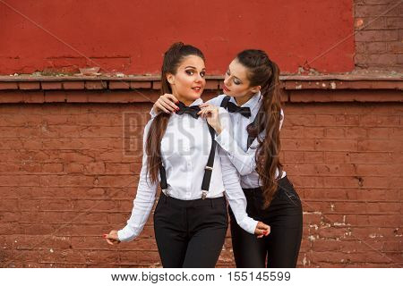 She Straightens Her Friend Bow Tie.