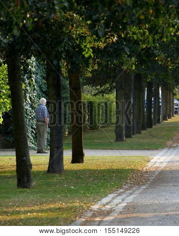 POTSDAM GERMANY. SEPTEMBER 1ST 2016: Senior man waiting somebody to come