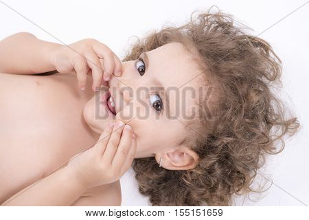 Happy Female Child Touching Her Face