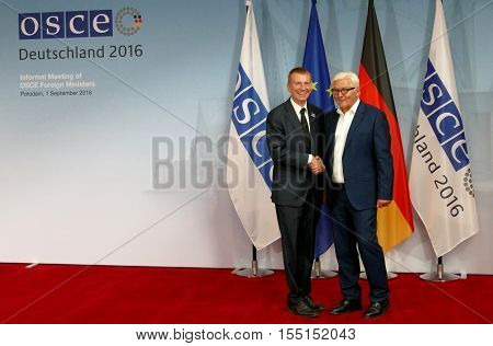 POTSDAM GERMANY. SEPTEMBER 1ST 2016: Federal Foreign Minister Dr Frank-Walter Steinmeier welcomes Edgars Rinkevics Minister of Foreign Affairs of Republic of Latvia to the Informal OSCE Foreign Minister's Meeting held in Potsdam Germany