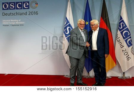 POTSDAM GERMANY. SEPTEMBER 1ST 2016: Federal Foreign Minister Dr Frank-Walter Steinmeier welcomes Witold Waszczykowski Minister of Foreign Affairs of Republic of Poland to the Informal OSCE Foreign Minister's Meeting held in Potsdam Germany