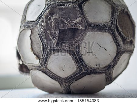 Very old cracked ramshackle ball for soccer or football