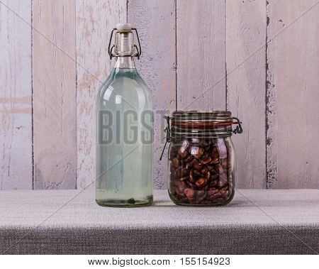 Иottle of stale water and the glass jar with beans