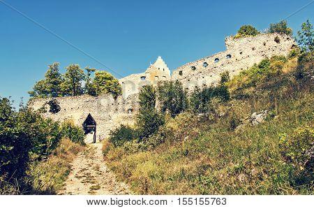 Access road to the ruin castle of Topolcany Slovak republic central Europe. Architectural theme. Beautiful place. Retro photo filter. Travel destination.