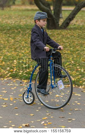PRAGUE CZECH REPUBLIC - NOVEMBER 5 2016: Unidentified boy participant in high wheeler race
