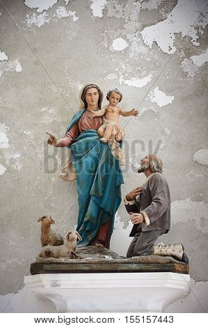 Sculpture of Saint Mary in old church Italy Europe