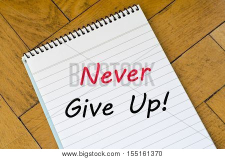 Never give up text concept write on notebook