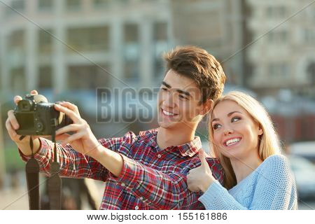 Young couple with camera on a street