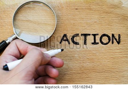 Human hand over wooden background and action text concept