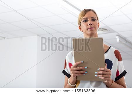 Serious Businesswoman Holding A Tablet