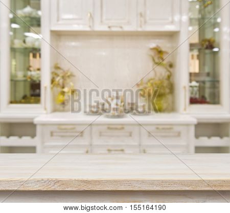 Beige table on defocused white kitchen furniture background