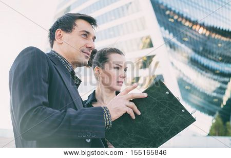 Businessman And Businesswomen Outside Office