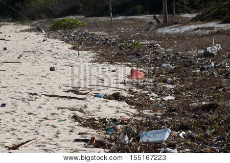 Pollution: garbages, plastic, and wastes on the beach after winter storms