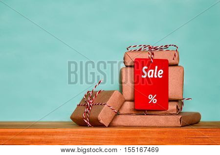 Christmas sale concept stack of christmas presents with red tag with sale word with the meaning of discount