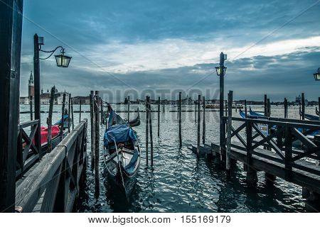 Venitian gondola at the pier waiting for costumers Italy