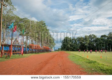 LOEI THAILAND-August 18 : Students play football in football field with sky on August 18 2016 in Thailand.