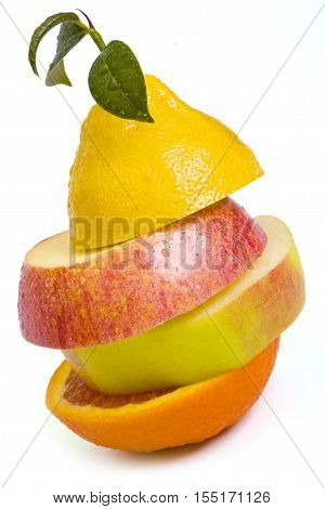 Composition made from pieces of apple lemon and orange isolated on white