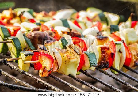 Closeup of hot skewers on the grate