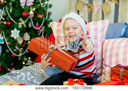 Happy Child Boy With Christmas Gifts