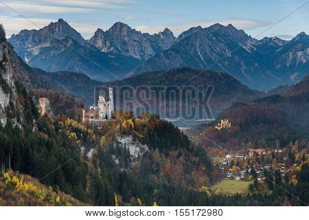 View of Neuschwanstein castle and Hohenschwangau castle from cable car to the top of Tegelberg with mountain view in autumn as background