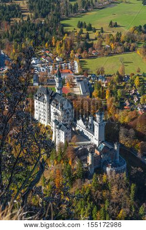 View of the world famous Neuschwanstein castle in autumn / event from the vantage point on Tegelberg