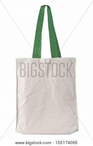 White fabric bag with green handle isolated on white background