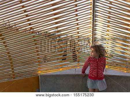 5th of November 2016 Bondi Beach Sydney Australia. Little girl playing inside the interactive sculpture titled Dynamics in Impermanence by Nicole Larking during the Sculpture by the Sea event