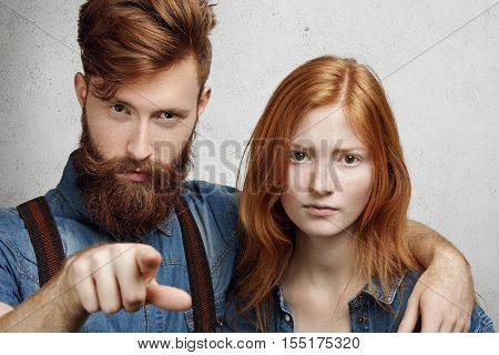 Negative Human Face Expressions And Emotions. Angry Caucasian Man With Fuzzy Beard Hugging His Shy A